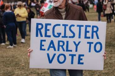 """Sign that reads """"Register Early to Vote""""."""