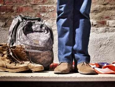 Veteran boots next to National Guard Bag