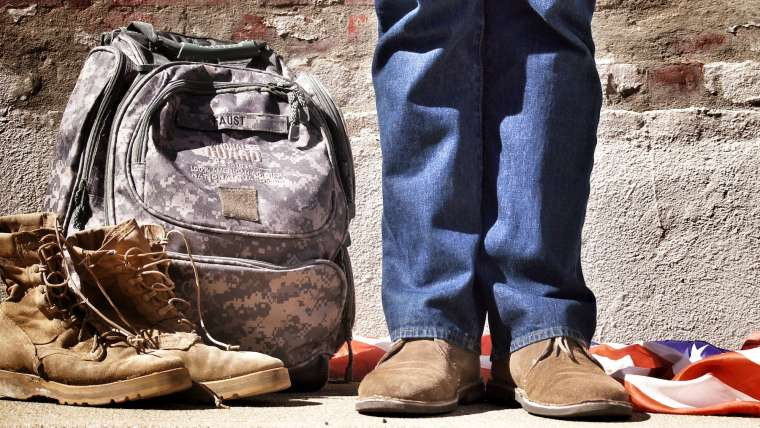 Veteran boots next to National Guard Bag